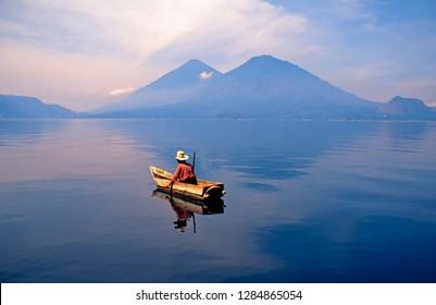 Lake Atitlan, Guatemala Highlands, Guatemala, Mayan fisherman surrounded by volcanic peaks, April 30, 1999