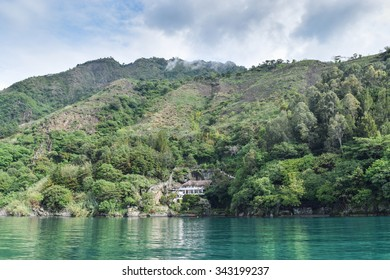 Lake Atitlan, Guatemala â?? June 6, 2015: Luxury homes line the banks of Lake Atitlan in the Guatemalan Highlands, where local people still live traditional lifestyles and worship ancient Mayan gods.