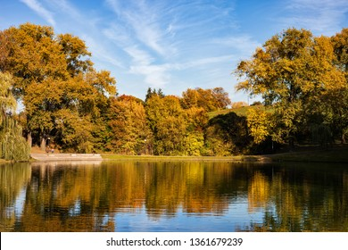 Lake and autumn foliage in Moczydlo Park, city of Warsaw in Poland