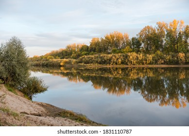 Lake in the autumn forest. Reflection in the lake. The season is autumn. Multicolored autumn leaves. Lake in the forest. Forest in different colors. Autumn landscape.