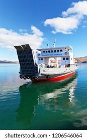 LAKE BAIKAL, IRKUTSK REGION, RUSSIA - October 14, 2018: Freight regular passenger ferry arrives from Olkhon Island on a sunny autumn day (translation of the ship's name: Olkhon Gate)