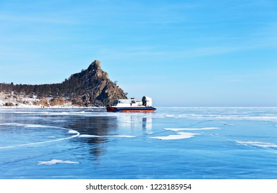 Lake Baikal in winter. The hovercraft Khivus brought tourists on the ice to the camp site in the famous Sandy Bay (Peschanaya Bay) for the winter holidays