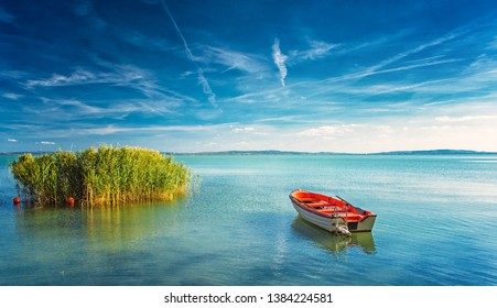 Lake Balaton with a red boat on a sunny day