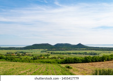 Lake Balaton scenery with the Castle Hill of Szigliget and other volcanic monadnocks of Balaton Highlands seen from Hegymagas, Saint George Hill