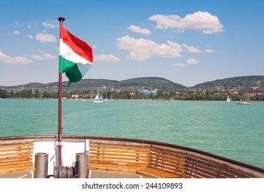Lake Balaton from a ship deck with a hungarian flag near to Tihany in Hungary.
