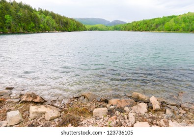 a lake at the base of mountains at Acadia National Park in Maine