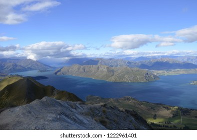 Lake between the mountains, popular hiking path in New Zealand, on the top of the mountains, mountain view, mountain skyline in-between a huge lake