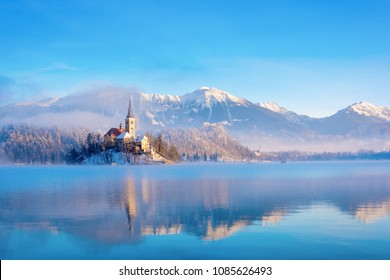 Lake bled on a winter sunny morning with clear sky and snow covering the mountains