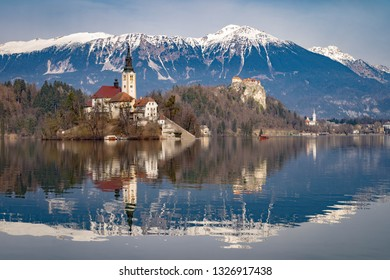 Lake bled in Slovenia with the ascension church, the castle and the Julian Alps at the background