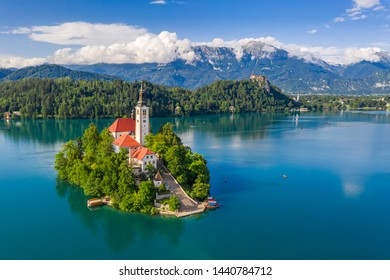 Lake Bled, Slovenia - Beautiful aerial view of Lake Bled (Blejsko Jezero) with the Pilgrimage Church of the Assumption of Maria on a small island and Bled Castle and Julian Alps at backgroud at summer