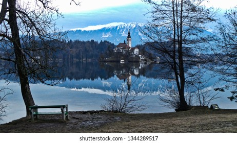 Lake Bled Slovenia. Beautiful mountain lake with small Pilgrimage Church. Most famous Slovenian lake and island Bled with Pilgrimage Church and Bled Castle in background. - image