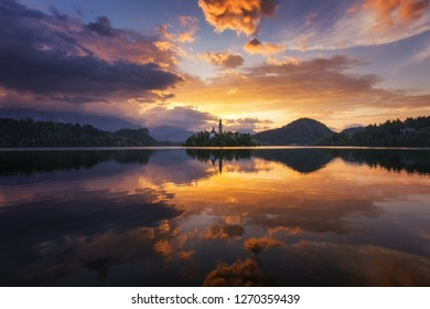 Lake Bled Slovenia. Beautiful sunrise over Bled lake with small Pilgrimage Church. Most famous Slovenian lake and island Bled with Pilgrimage Church of the Assumption of Maria. Bled, Slovenia.