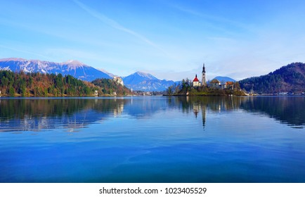 Lake Bled Slovenia. Most famous and beautiful Slovenian lake ,island Bled with small Pilgrimage Church,the Assumption of Maria and Bled Castle in background