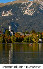 Lake Bled in Slovenia is the oldest medieval town in Slovenia .Tourist boat on the on Lake Ble.  Mountains in background. Slovenia, Europe. European travel