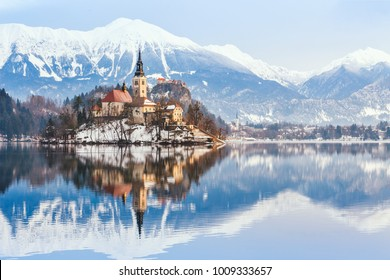 Lake Bled with St. Marys Church of the Assumption on the small island; Bled, Slovenia, Europe.