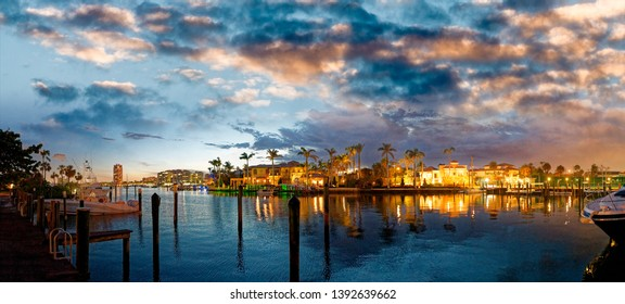 Lake Boca Raton and city skyline with reflections at sunset, panoramic view.