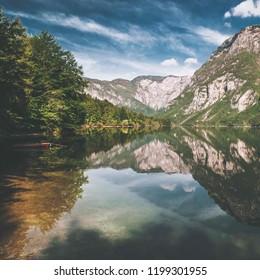 Lake Bohinj, landscape with lake and mountain on background. Ama