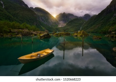 Lake Bondhus during cloudy weather with sun and boat