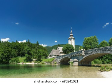 A lake, bridge, and church in Bohinj, Slovenia.