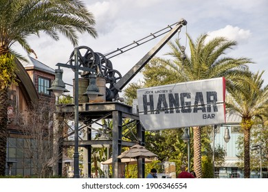LAKE BUENA VISTA, FL, USA - JANUARY 16, 2021: The exterior and sign of Jock Lindsey's Hangar Bar, which is an airplane hangar turned into a dive bar. Based off of Indiana Jones.