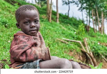 LAKE BUNYONYI, UGANDA - OCTOBER 21: Unidentified Batwa pigmy boy on October 21, 2012 at Lake Bunyonyi, Uganda. Pigmy people are ancient dwellers in the forests, they were known as 'The Keepers of the Forest'