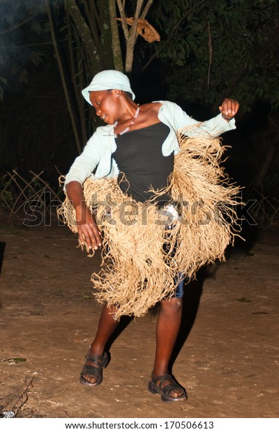 LAKE BUNYONYI, UGANDA - OCTOBER 22: Batwa pygmie dancing on October 22, 2012 at Lake Bunyonyi, Uganda. Pygmy people are ancient dwellers in the forests, they were known as The Keepers of the Forest.