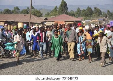 LAKE BUNYONYI, UGANDA/AFRICA - 07 19 2010: [Angry mob following a woman accused of adultery]