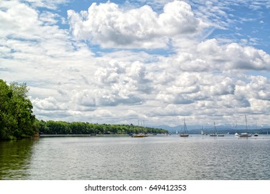 Lake called Ammersee with a blue clouded sky above and the bavarian alps in the background, Germany, Bavaria
