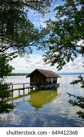 Lake called Ammersee with a wooden hut and a stage, bavarian alps in the background, Germany, Bavaria