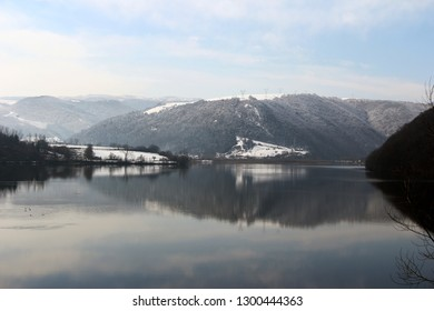 lake and carpathian mountains landscape in winter in Romania