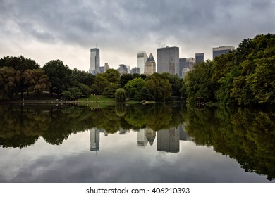 The lake at Central Park in New York City with the Manhattan skyline in the background and reflections in the water.