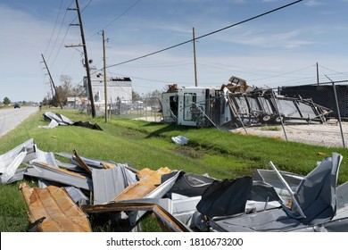 Lake Charles, Louisiana. USA - September 6, 2020:  Hurricane Laura. Destruction from strong winds. Upside down RV and a pile of rubbish by the road