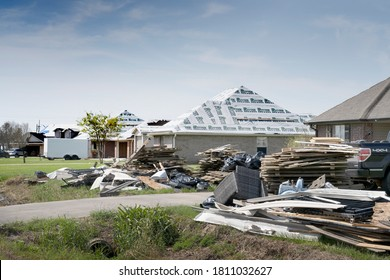 Lake Charles, Louisiana. USA - September 6, 2020:  Hurricane Laura. The destruction of the roofs of new houses by the strong wind, repairs and mountains of debris near the road