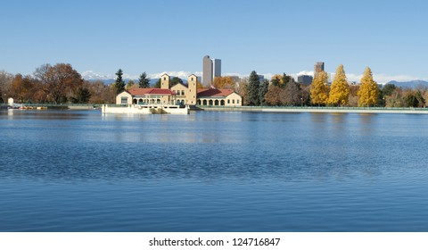 The lake at City Park in Denver, with skyscrapers and mountains in the background.