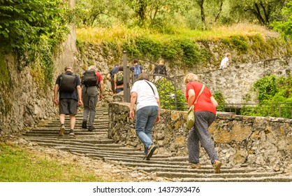 LAKE COMO, ITALY - JUNE 2019: People wlaking up steps on the route of a walking trail along part of Lake Come - the Greenway del Lago di Como.