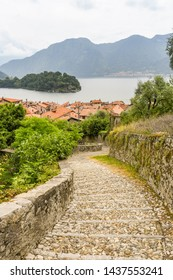 LAKE COMO, ITALY - JUNE 2019: Stone steps on the route of a walking trail along part of Lake Come - the Greenway del Lago di Como.