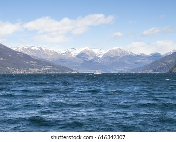 Lake of Como, Italy: Picture of the lake to the north with snow-capped mountains. The wind makes the evocative image.