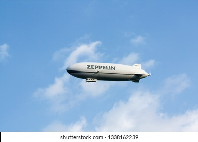 Lake of Constance, Germany - May 22, 2010:: Airship, zeppelin flying in the blue sky with white clouds. Zeppllin airships often offer tourist passagers for leisure flights.