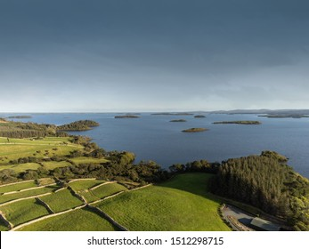 Lake Corrib, county Galway Ireland, Sunny day with clean blue sky and green fields separated by stone fences, islands in the lake, Aerial drone view,