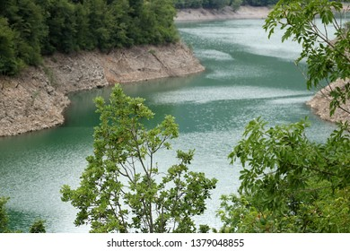 Lake created by artificial dam.  Vagli, Garfagnana, Lucca, Tuscany. Italy. A dam used to produce electricity delimits an artificial lake in the Tuscan mountains.