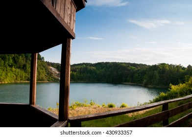 Lake with crystal clear water , green forest and house viewing