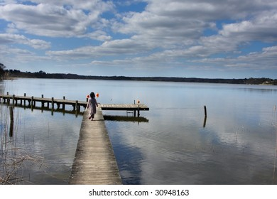 a lake in denmark with child playing