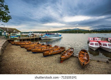 Lake District, Cumbria - Traditional wooden boats and tourist boat at Derwentwater, Keswick at sunset with cloudy sky - England