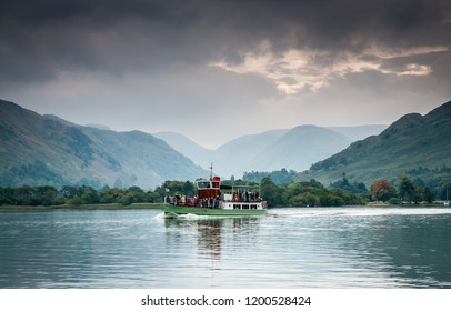 Lake District, Cumbria, UK. September 2013. A steam boat carrying passengers on the waters of Ullswater, Lake District, England on a cloudy looking day in Autumn