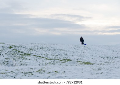 The Lake District, Keswick, England, 01/17/2016, People sledging in the Winter snow