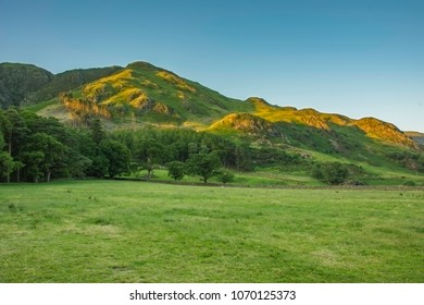 Lake District National Park Landscape in spring.Light and afternoon shadow over scenic mountain valley,clear blue sky.Cumbria landscape in spring.Mountains in North West England.Natural world,Nature.