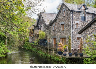 Lake District, United Kingdom - May 09, 2015: Grasmere village cottages with flower pots, the Lake District, Cumbria, England
