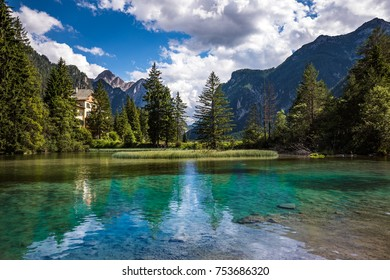 Lake Dobbiaco in the Dolomites, Beautiful Nature Italy natural landscape Alps.