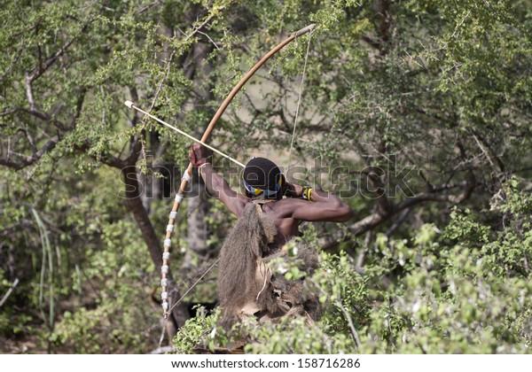 LAKE EYASI, ARUSHA/TANZANIA-CIRCA FEBRUARY 2013: an unidentified member of the Hadza tribe hunts circa Feb 2013 in Lake Eyasi. Hadza is the last tribe of hunter-gatherer, clic-speakers of Tanzania.