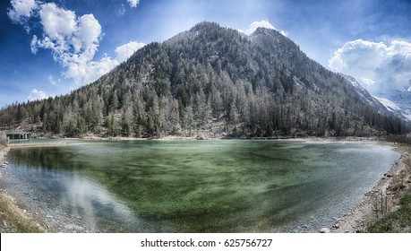 Lake of the Fairies with mountain and blue sky in background near little village of Macugnaga
